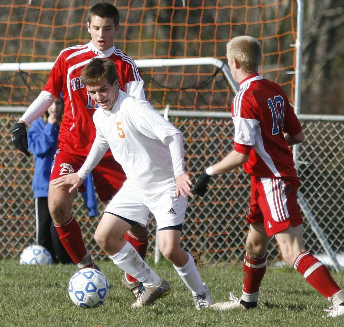 Dispatch Staff Photo by JOHN HAEGER twitter.com/oneidaphoto Oneida's Cary Reifschneider (5) looks to pass the ball as New Hartford's Ben Gilroy (12) and Luke Bogar (10) defends in the first half of the Sec III playoff match in Oneida on Friday, Oct. 28, 2011. Oneida won the match 2-1 to advance to the next round.