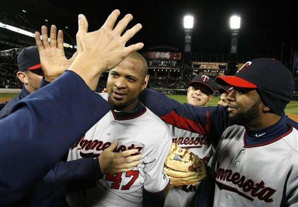 Minnesota Twins starting pitcher Francisco Liriano, center, celebrates his no-hitter and 1-0 win over Chicago White Sox with his teammates after a baseball game Tuesday, May 3, 2011 in Chicago. (AP Photo/Charles Rex Arbogast)