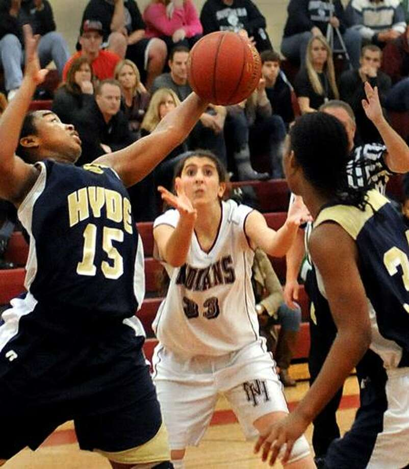 Hyde's Maya Eggleston, left, grabs a rebound before North Haven's Brianne Melillo can get it in third-quarter action during the Howling Wolves' 58-28 win on Tuesday night in the North Haven Holiday Tournament. (Melanie Stengel/Register)
