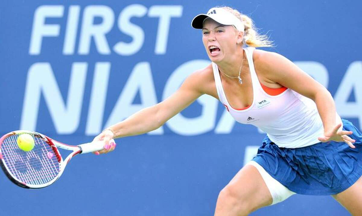 Caroline Wozniacki hits a forehand against Petra Cetkovska in the first set of the singles final of the New Haven Open at Yale on 8/27/2011.Photo by Arnold Gold/New Haven Register AG0422B