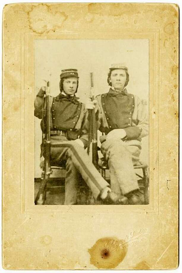 AP Photo/Courtesy of the Library of Virginia This photograph provided by the Library of Virginia shows William Henry Taylor, left, and Stephen Stewart, members of the 11th Virginia Infantry. The photograph  is among the 25,000 mementoes the Library of Virginia has scanned as archivists travel the state seeking documents, letters and diaries dating to the Civil War. Virginia is among a number of states attempting to collect Civil War documents that are in the possession of families, tucked away in trunks and attics. Photo: ASSOCIATED PRESS / AP2011