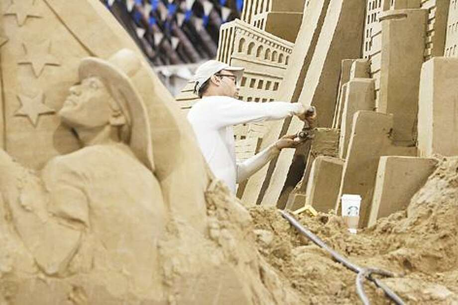 Dispatch Staff Photo by JOHN HAEGER (Twitter.com/OneidaPhoto) Patrick Harsch of Team Sandtastic works on a section of the 9/11 tribute sand sculpture at the NYS Fair on Friday, Aug. 26, 2011.