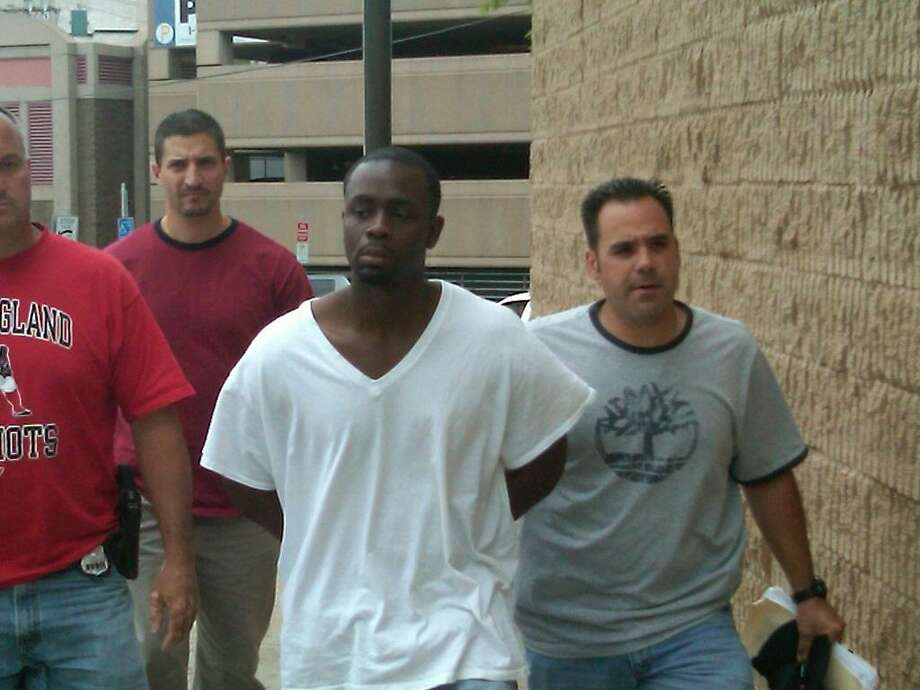 File photo Christian Hicks in custody following his arrest