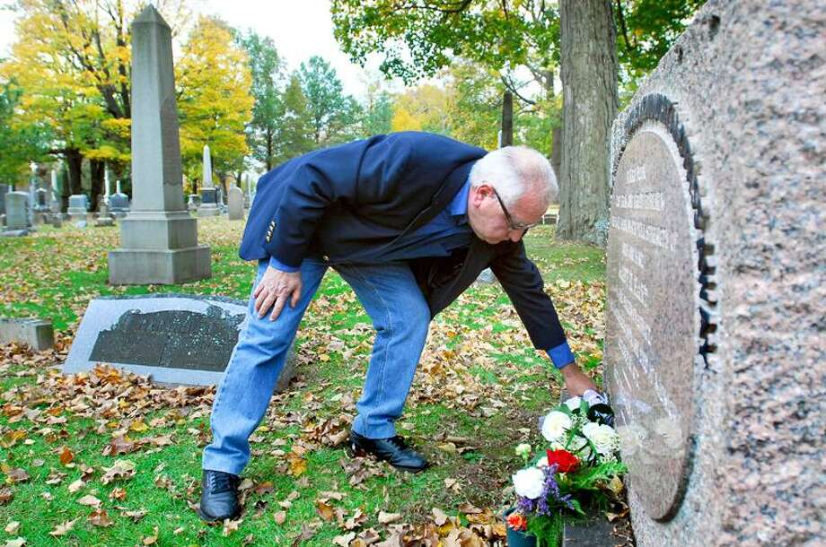 "Arnold Gold/Register: Vincent Casanova leaves a bouquet of flowers at the Evergreen Cemetery grave of ""Midnight Mary"" Hart, whose legend inspired his Halloween poem."