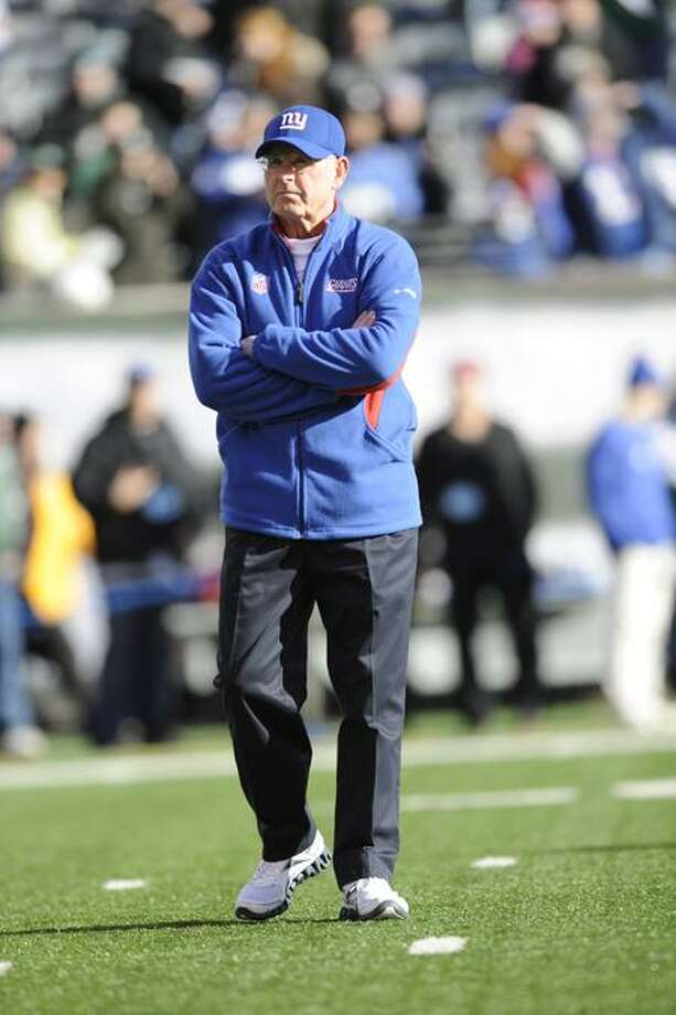 New York Giants head coach Tom Coughlin before an NFL football game between the New York Giants and the New York Jets, Saturday, Dec. 24, 2011, in East Rutherford, N.J. (AP Photo/Bill Kostroun) Photo: AP / AP2011