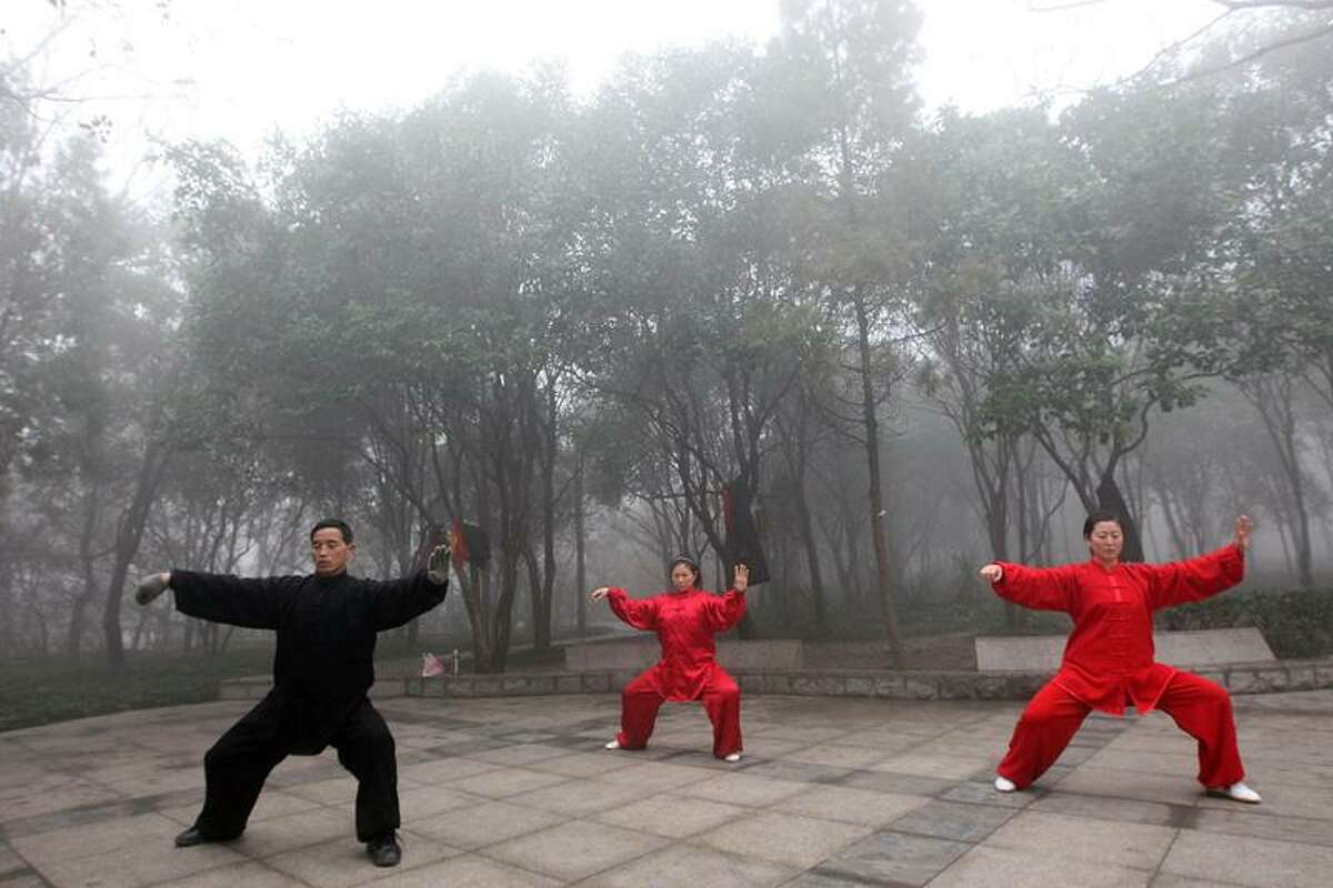 Residents practise Tai chi chuan amid thick fog in Huaibei in central China's Anhui province on Tuesday, Dec. 1, 2009.(Photo By Xie Zhengyi/Color China Photo/AP Images)