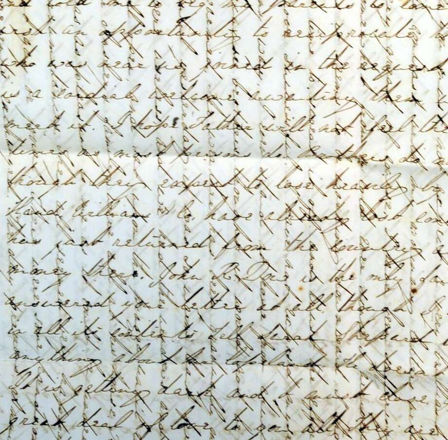 A detail of a letter involved in Civil War correspondence at the Charlotte L. Evarts Memorial Archive in Madison. The writing goes in two directions. Photo by Mara Lavitt/New Haven Register12/16/11