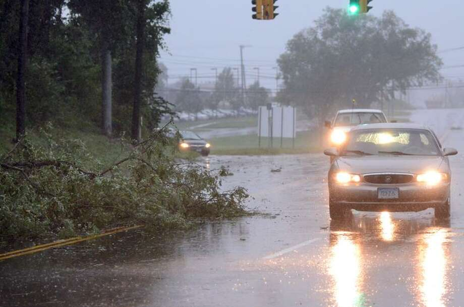 Cars manuever around the eastbound lane of Rt 1 in Branford during the morning hours of Irene Sunday morning. VM Williams 08.28.11