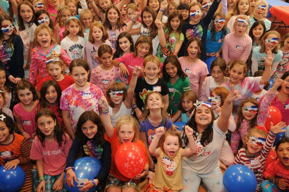 Guilford-Some of the girls gathered for the Almost Sleepover at the Knights of Columbus Hall in Guilford. Melanie Stengel/Register