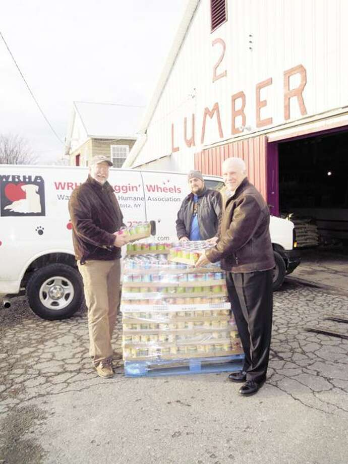 Photo Courtesy WANDERERS' REST From left are Glenn H. Ivers, executive director Wanderers' Rest Humane Association, Patrick Kime, and Doug Tudman, director sales and marketing at Isadore A. Rapasadi & Sons. Rapasadi transported the pallets from the Del Monte warehouse in Pennsylvania to Canastota. Kime's hardware store in Canastota is warehousing the pallets and helping to load them for the different organizations as they arrive to receive their pallet.