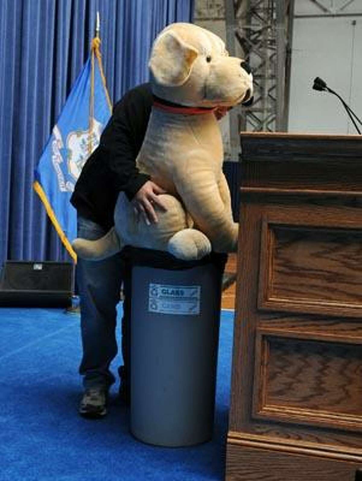 Hartford--A stuffed toy dog serves as a stand-in at the podium during Tuesday's preparation for Wednesday's State of Connecticut Gubernatorial Inauguration at the Connecticut State Armory. Photo by Brad Horrigan/New Haven Register-01.04.11.
