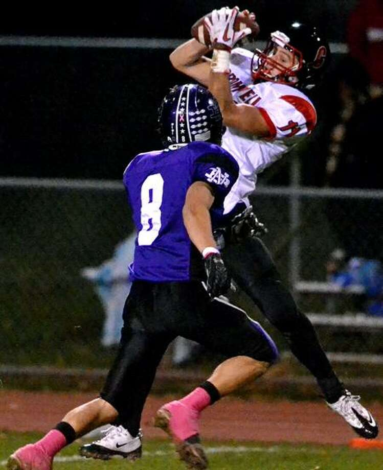 Cromwell wide reciever, Michael Antonio caught a deep pass down the sidelines before being tackled by North Branford defensive back, Ryan Magnotti. Photo by Sean Meenaghan/New Haven Register.