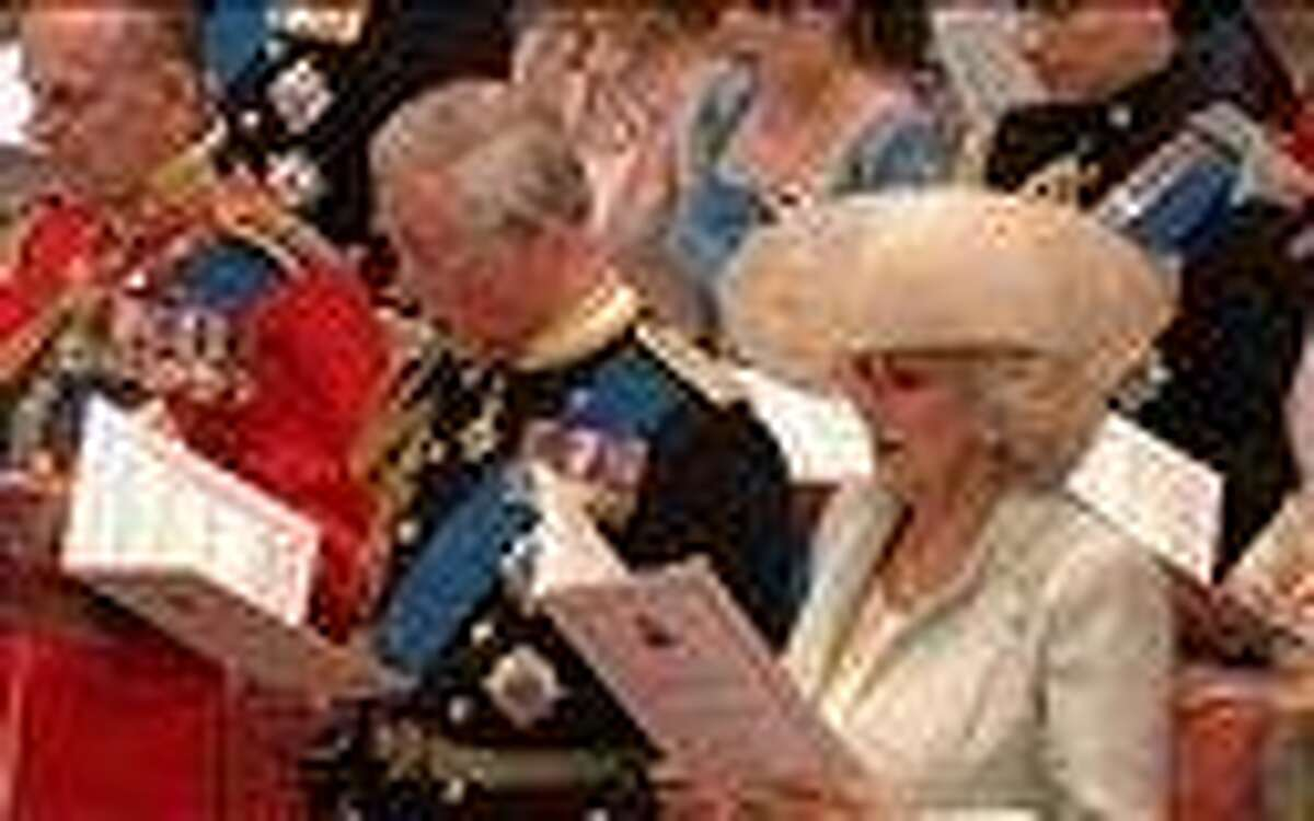 In this image taken from video, From left, Britain's Prince Philip, Britain's Prince Charles, and Camilla, Duchess of Cornwall, sing during the ceremony at Westminster Abbey for the Royal Wedding in London on Friday, April, 29, 2011. (AP Photo/APTN)