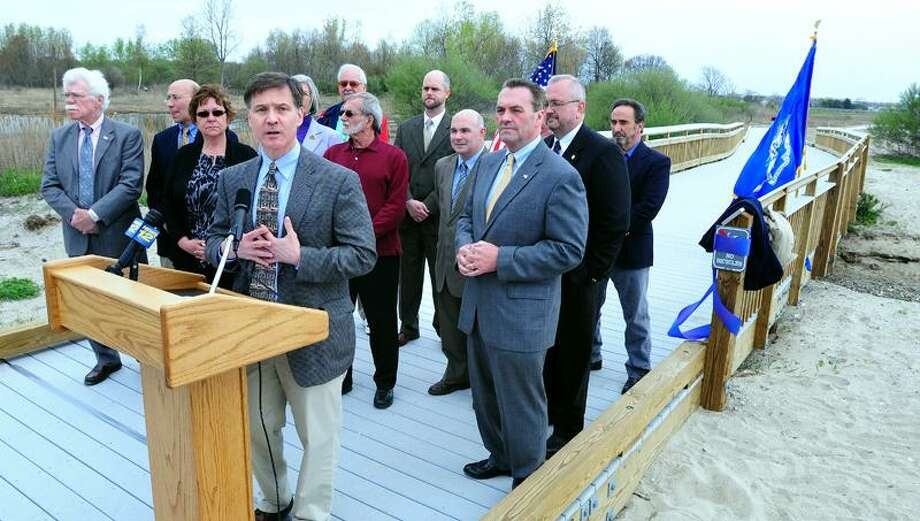 Daniel Esty (left, at podium) speaks before a ribbon cutting for the Silver Sands Boardwalk where it meets Walnut Beach in Milford on 5/2/2011. Photo by Arnold Gold/New Haven Register