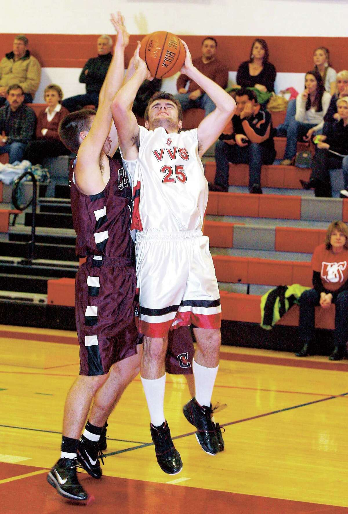Dispatch File Photo by JOHN HAEGER VVS' Nash Robb (25) puts up a shot as Clinton's Devin Comelius (12) defends in a Tri-Valley League game at VVS on January 18, 2011. Both schools decided to leave the TVL for the 2011-12 school year.