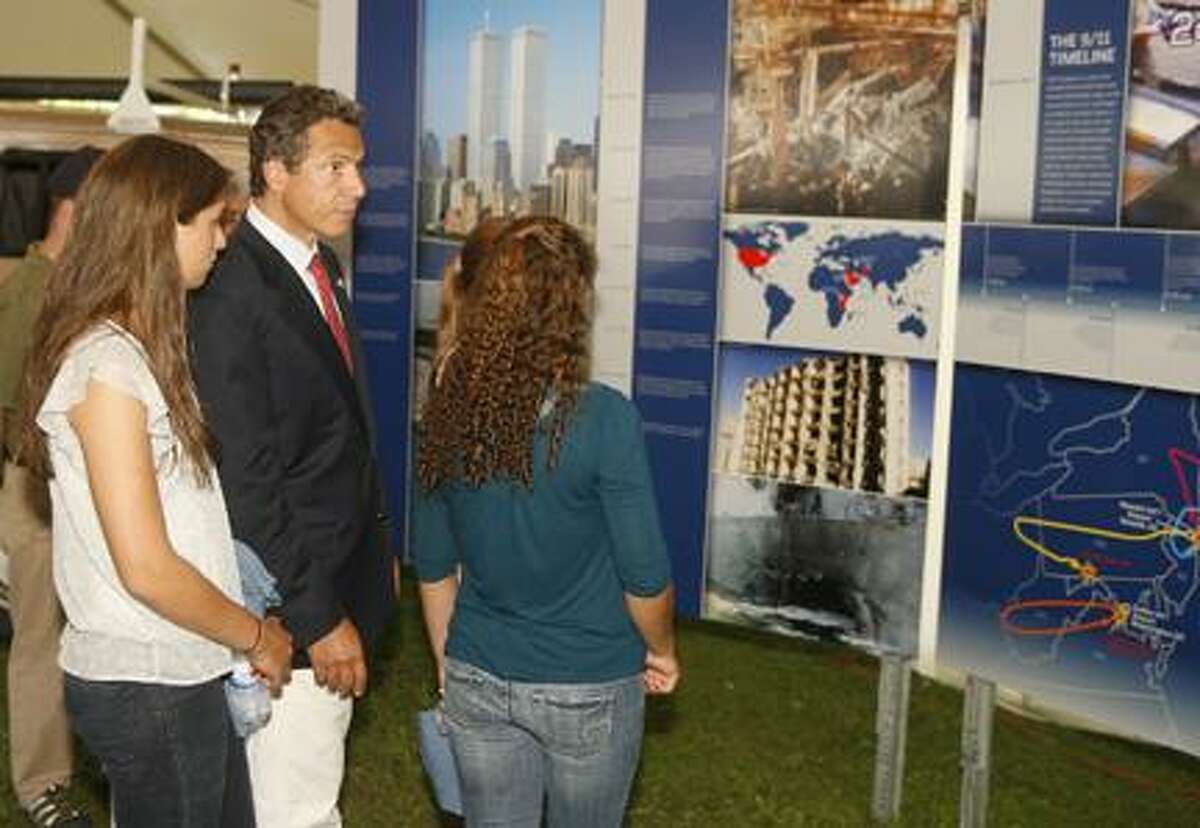Dispatch Staff Photo by JOHN HAEGER (Twitter.com/OneidaPhoto)New York Gov. Andrew Cuomo and his daughters look at a timeline of the 9/11 attacks at the New York State Fair in Geddes on opening day on Thursday, Aug. 25, 2011. The fair runs through Labor Day.