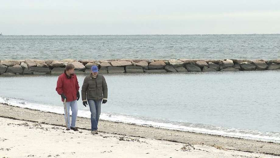 Contributed photo: Jim Hood, left, business consultant from Westport, and Hank Mandel, a retired banker, chat on a beach walk.