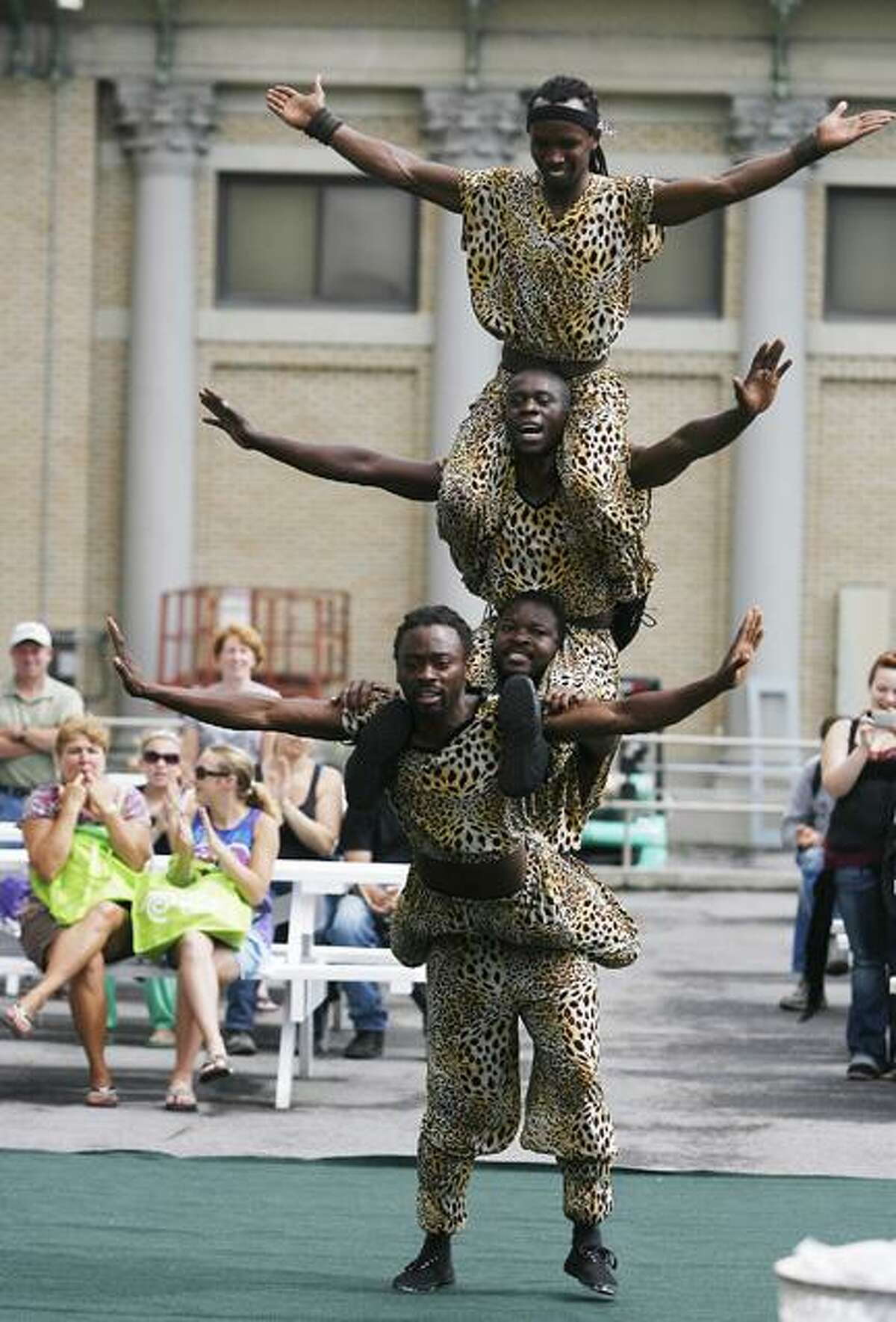 Dispatch Staff Photo by JOHN HAEGER (Twitter.com/OneidaPhoto)African Acrobats perform one of their several free shows at the New York State Fair in Geddes on opening day on Thursday, Aug. 25, 2011. The fair runs through Labor Day.