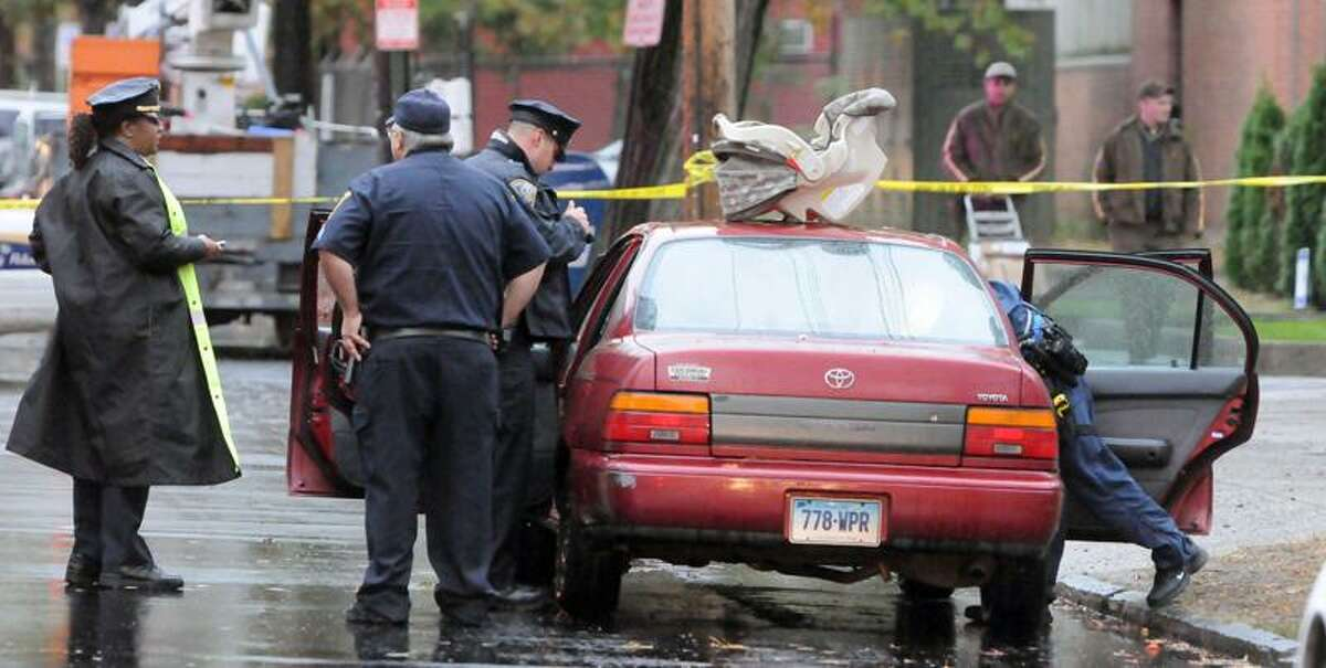 Police investigate a car on Shelton Avenue thought possibly to have been involved in a robbery at a jewelry store in downtown New Haven Thursday. The car was not involved, police determined. Mara Lavitt/Register