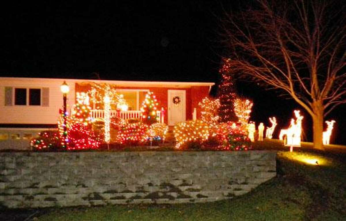 Photo Courtesy LIZBETH BLANCHARD Holiday lights brighten the lawn of Lizbeth Blanchard's home at 130 Pleasant St., Canastota.