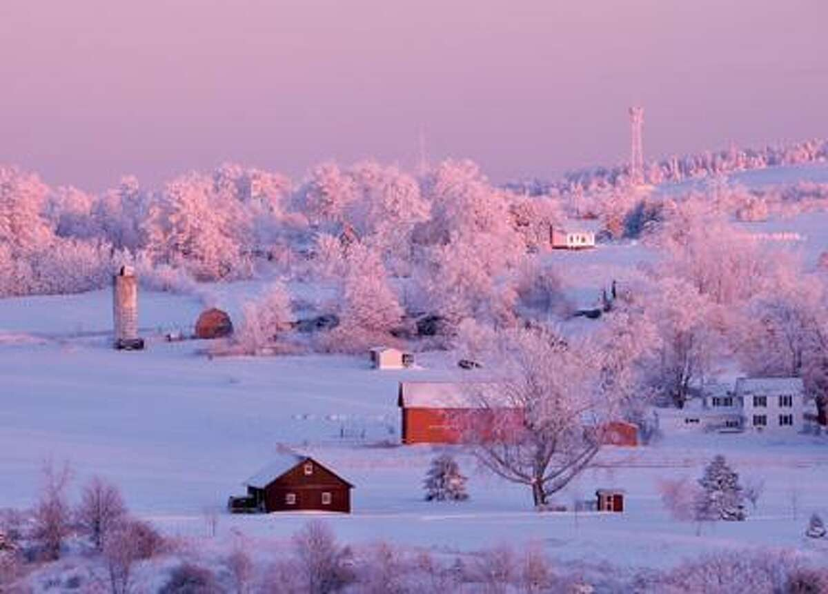 """Photo by Bob Havener Bob Havener's picture, """"Winter Sunset Afterglow,"""" of a hillside bathed in the waning light of the sun as seen from a road in Fenner. The photo will be the cover of the Oneida Daily Dispatch's 2012 calendar."""