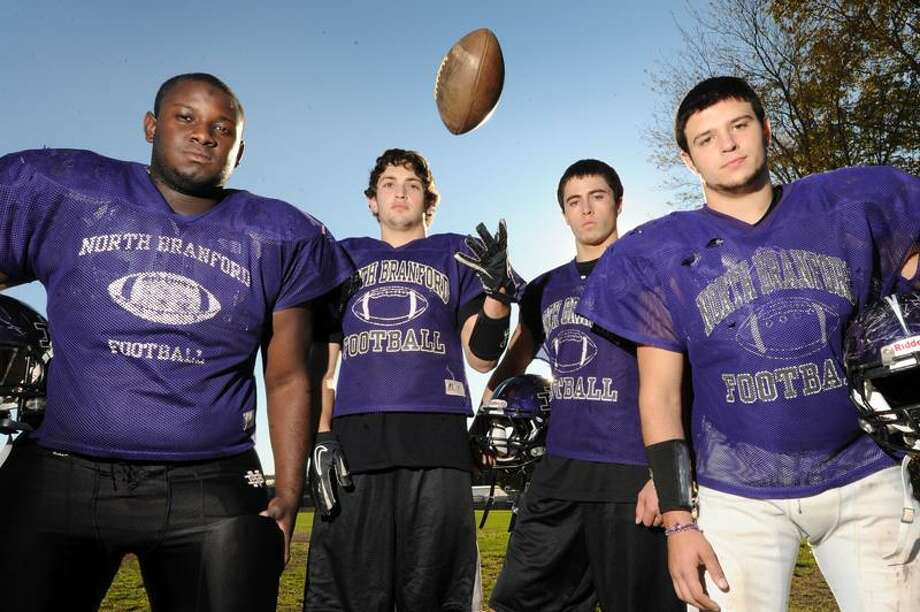 North Branford football captains Damoy Hunter, Cory Onofrio, Christian Perrotti and Anthony Franco pose for a picture at the North Branford football practice field Tuesday Oct 25, 2011. VM Williams