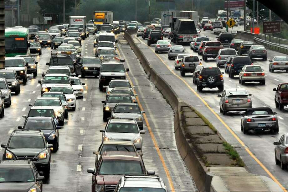Traffic on Interstate 95 at Exit 44 facing south was heavy Thursday afternoon, but less cars are expected to be traveling for the Labor Day holiday. (Melanie Stengel/Register)
