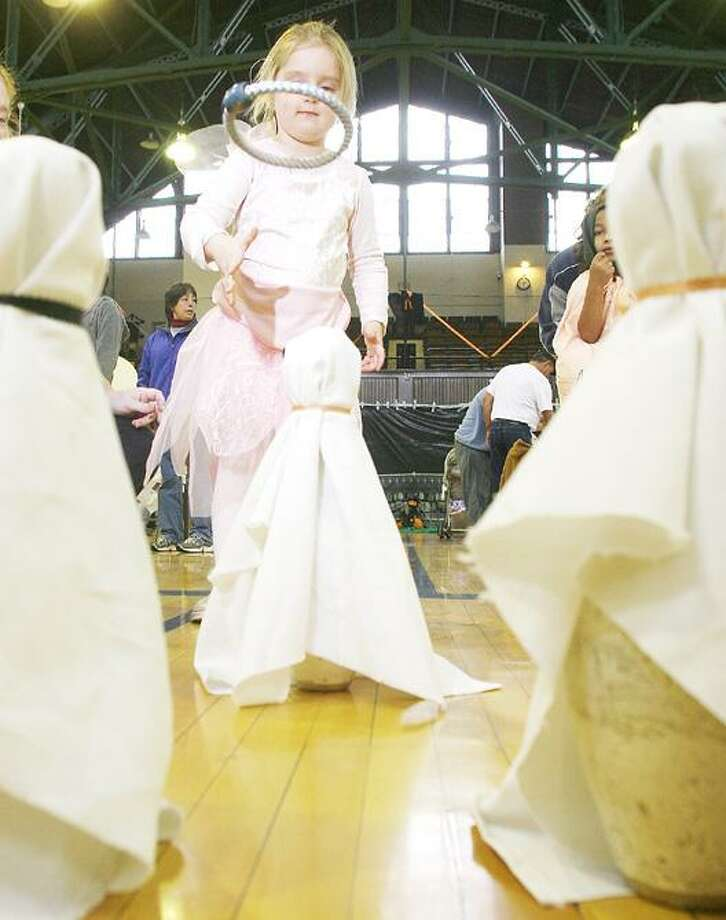 Photo by JOHN HAEGER (Twitter.com/OneidaPhoto) Hannah Leroy, then-5, of Oneida, tries to toss a ring  around a ghost during the annual Halloween Party at the Armory in the City of Oneida on Saturday, Oct. 24, 2009.