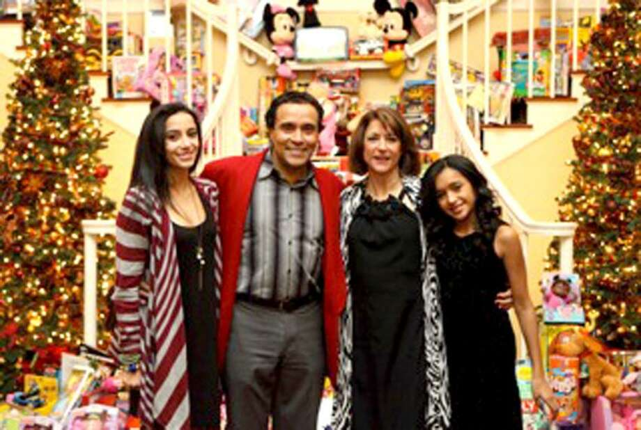 """Contributed photo: Joelle, Arti, Joanne and Alayna Dixson had cause to smile at the 2010 holiday party at Woodwinds in Branford. He calls the success of this toy drive, """"divine intervention."""""""