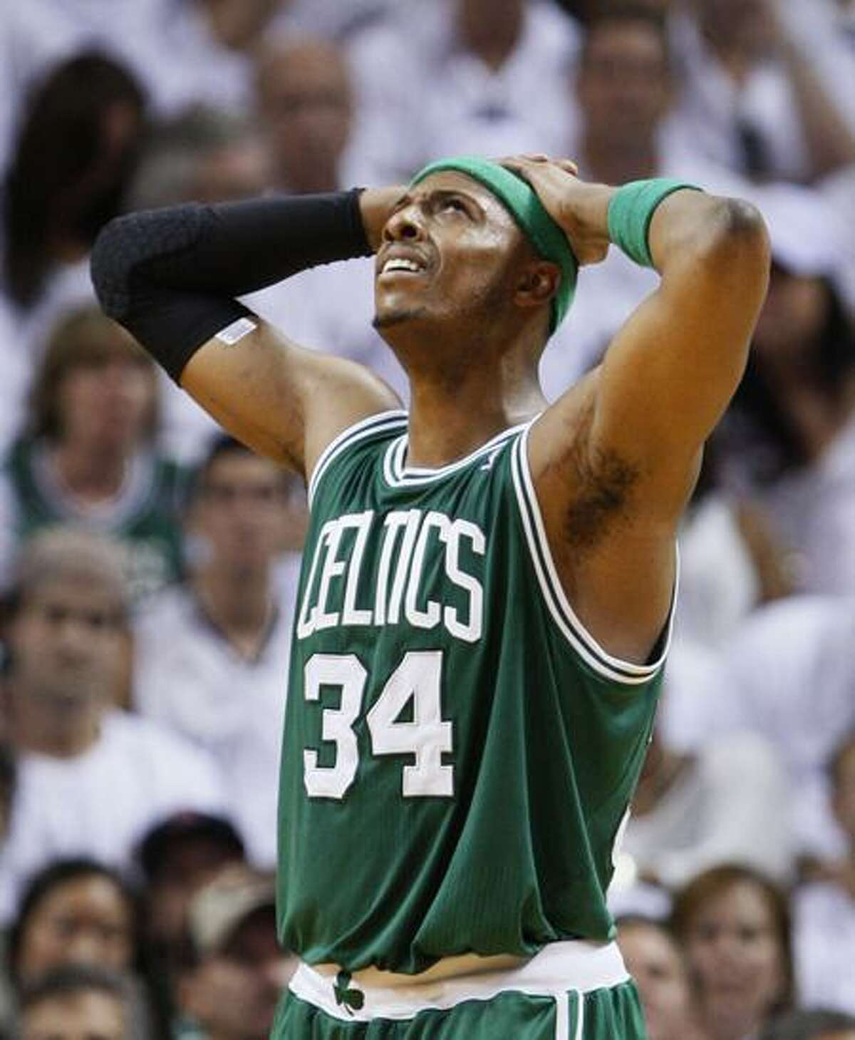 Boston Celtics' Paul Pierce reacts to a call against a teammate during the second half of Game 1 of a second-round NBA playoff basketball series against the Miami Heat, Sunday, May 1, 2011, in Miami. The Heat defeated the Celtics 99-90. (AP Photo/Wilfredo Lee)