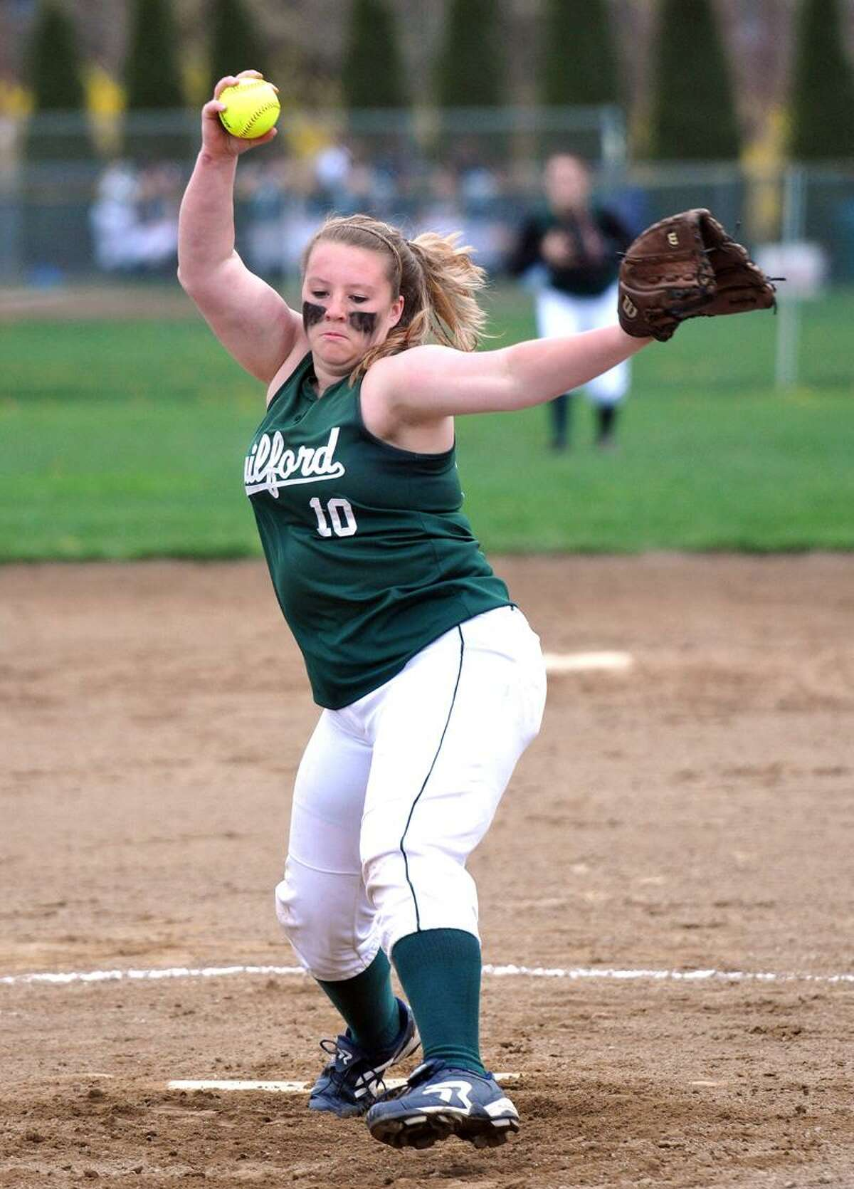 Guilford's Leah Torre winds up during the second inning against Hand. Photo by Peter Casolino/New Haven Register