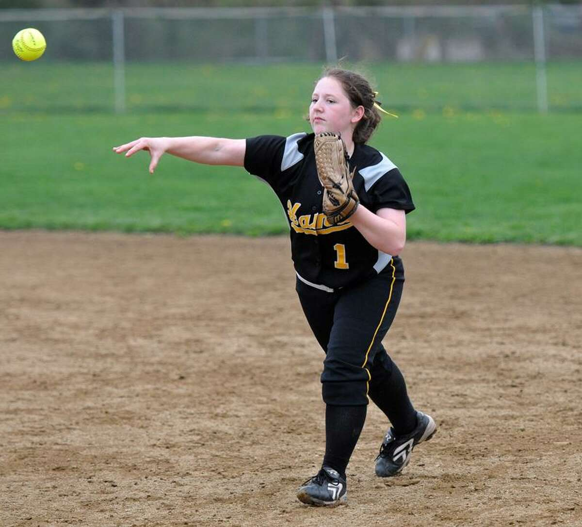 Hand's Ali Ruggiero makes the throw to first for the out against Guilford during the second inning. Photo by Peter Casolino/New Haven Register