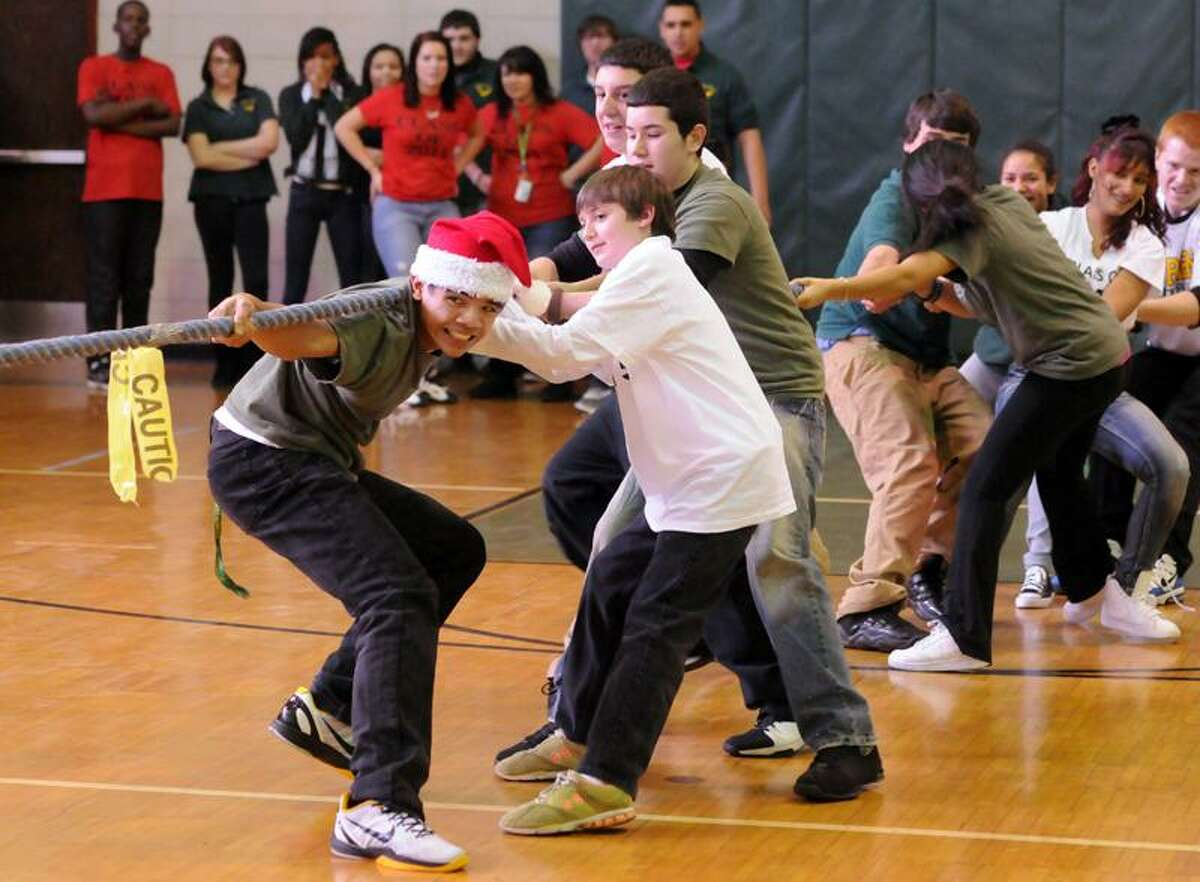 The annual Class Wars at Emmett O'Brien Technical High School. Members of the class of 2015, including Paul Makinano of Ansonia in Santa hat, battle in the tug-of-war. Mara Lavitt/Register