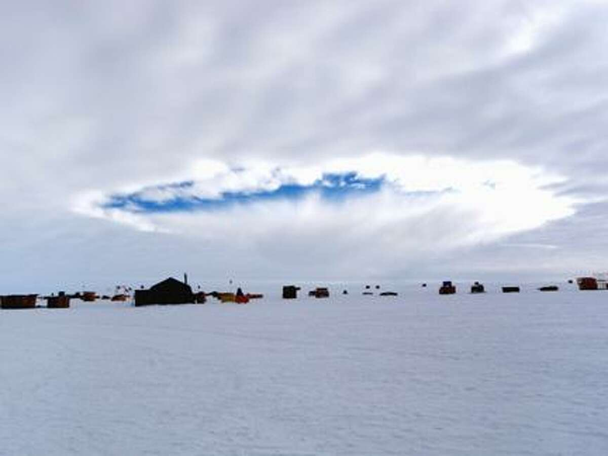 Photo Courtesy the journal ScienceAn aircraft-induced hole observed at the West Antarctic Ice Sheet Divide Camp, Antarctica. Airplanes flying through supercooled clouds around airports can cause condensation that results in more snow and rain nearby, according to a new study.