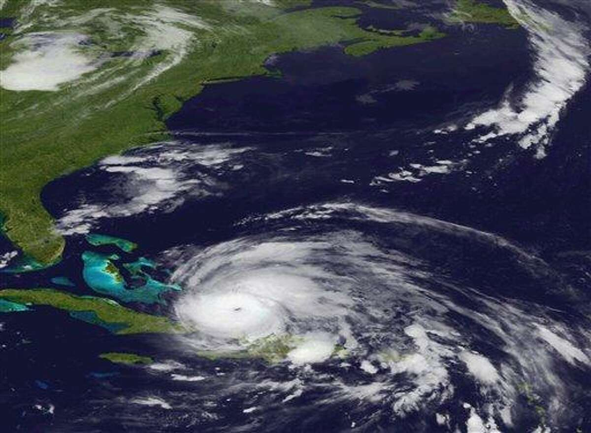 An image released by the NOAA made from the GEOS East satellite shows Hurricane Irene on Aug. 24, 2011 as it moves northwest from the Dominican Republic. Puerto Rico and the Dominican Republic. Federal officials have warned Irene could cause flooding, power outages or worse all along the East Coast as far north as Maine, even if it stays offshore. (AP Photo/NOAA)
