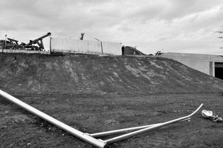 A sheared light pole down an embankment. ((Melanie Stengel photos/Register)
