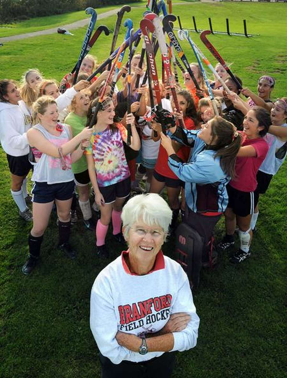 Longtime Branford field hockey coach Cathy McGuirk with her current team. Photo by Mara Lavitt/New Haven Register