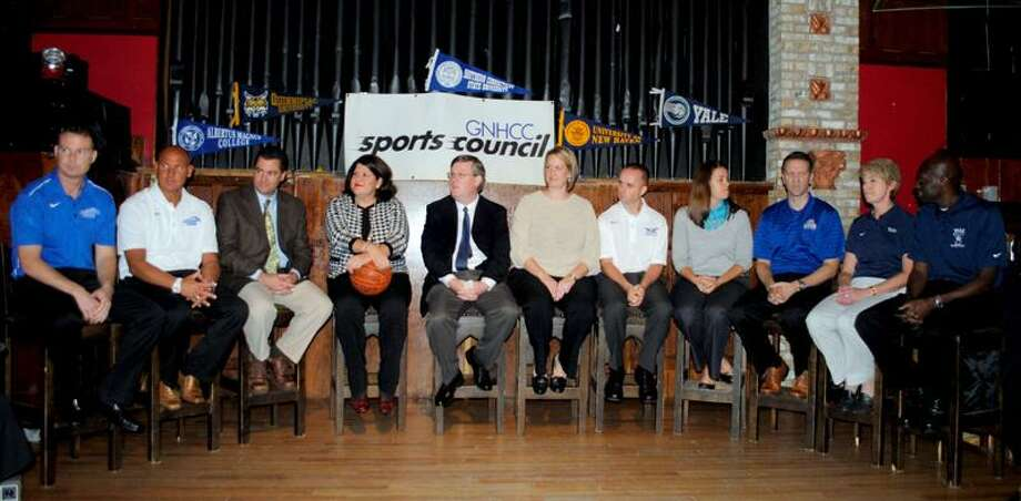 Men's and women's basketball coaches from Albertus Magnus, Quinnipiac, Southern Connecticut, New Haven and Yale gathered at the Wicked Wolf Tavern in New Haven for the GNHCC Sports Council on Wednesday. From left, Mitch Oliver, Steve Schuler, Tom Moore, Tricia Fabbri, moderator and Register sports editor Sean Barker, Meghan Brown, Michael Donnelly, Jessica Smith, Ted Hotaling, Chris Gobrecht and James Jones. (Kaitlin Bradshaw/For the Register)