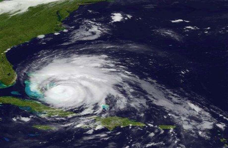 In an image provided by NOAA and made by the GOES East satellite Hurricane Irene is shown as it move over the Bahama Thursday Aug. 25, 2011.  Irene could hit North Carolina's Outer Banks on Saturday afternoon with winds around 115 mph (185 kph) and it's predicted to go up the East Coast, dumping rain from Virginia to New York City. (AP Photo/NOAA) Photo: AP / NOAA