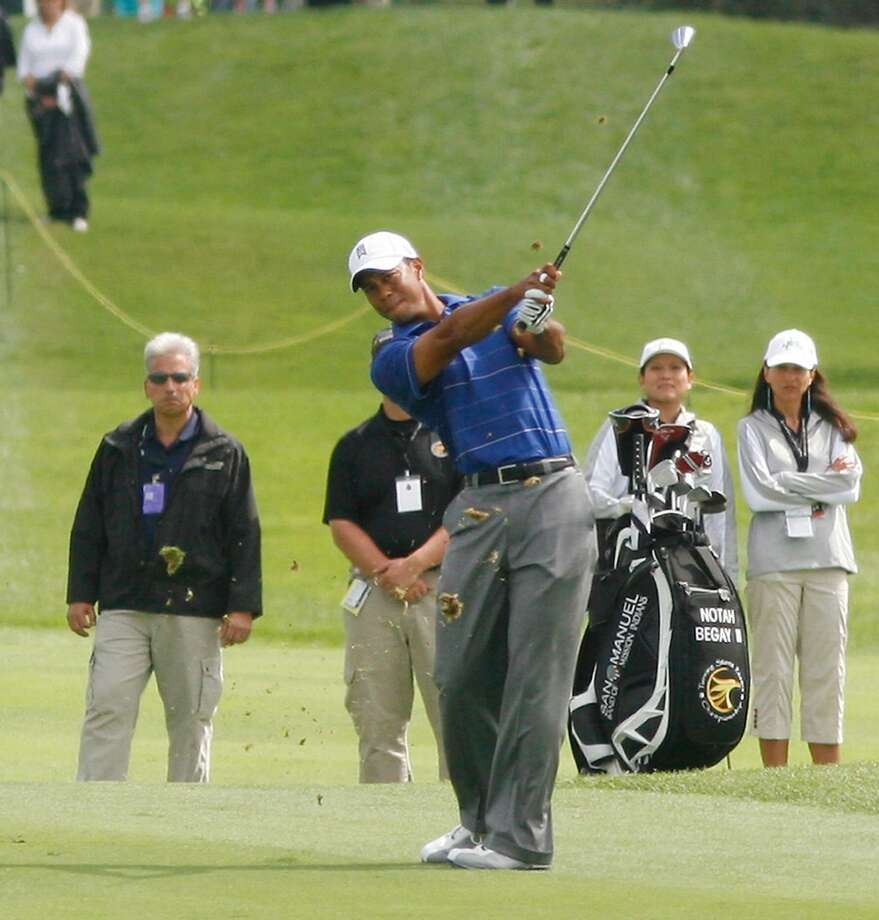 Dispatch Staff Photo by JOHN HAEGER Tiger Woods hits his second shot towards the first green during the Notah BeGay III Foundation Challenge on Monday, August 24, 2009 at  Atunyote Golf Club in Vernon. Woods will return for the NB3 Challenge in 2011.