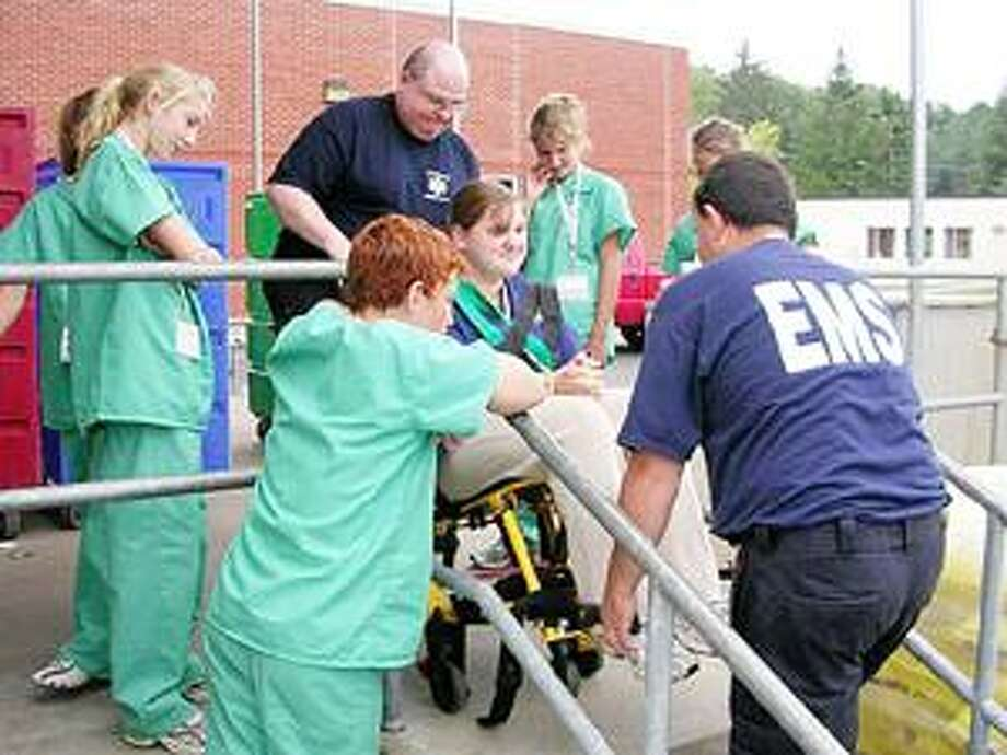 Photo Courtesy COMMUNITY MEMORIAL HOSPITAL Area students take part in 2008's M.A.S.H. Camp at Community Memorial Hospital.