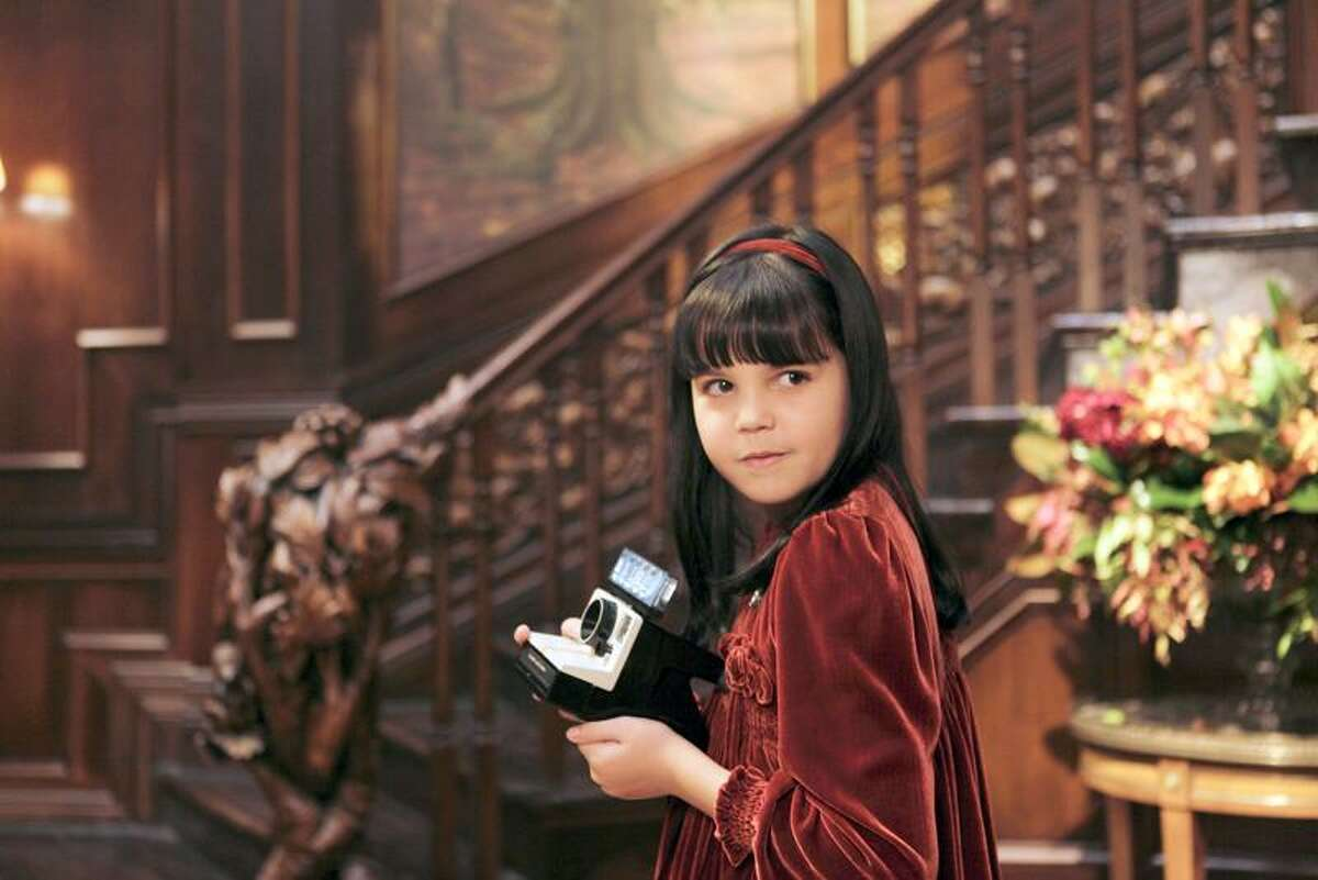 """Carolyn Johns/Film District photo: The kid (Bailee Madison) hears all kinds of spooky things in """"Don't Be Afraid of the Dark."""" Why is it the adults never can?"""