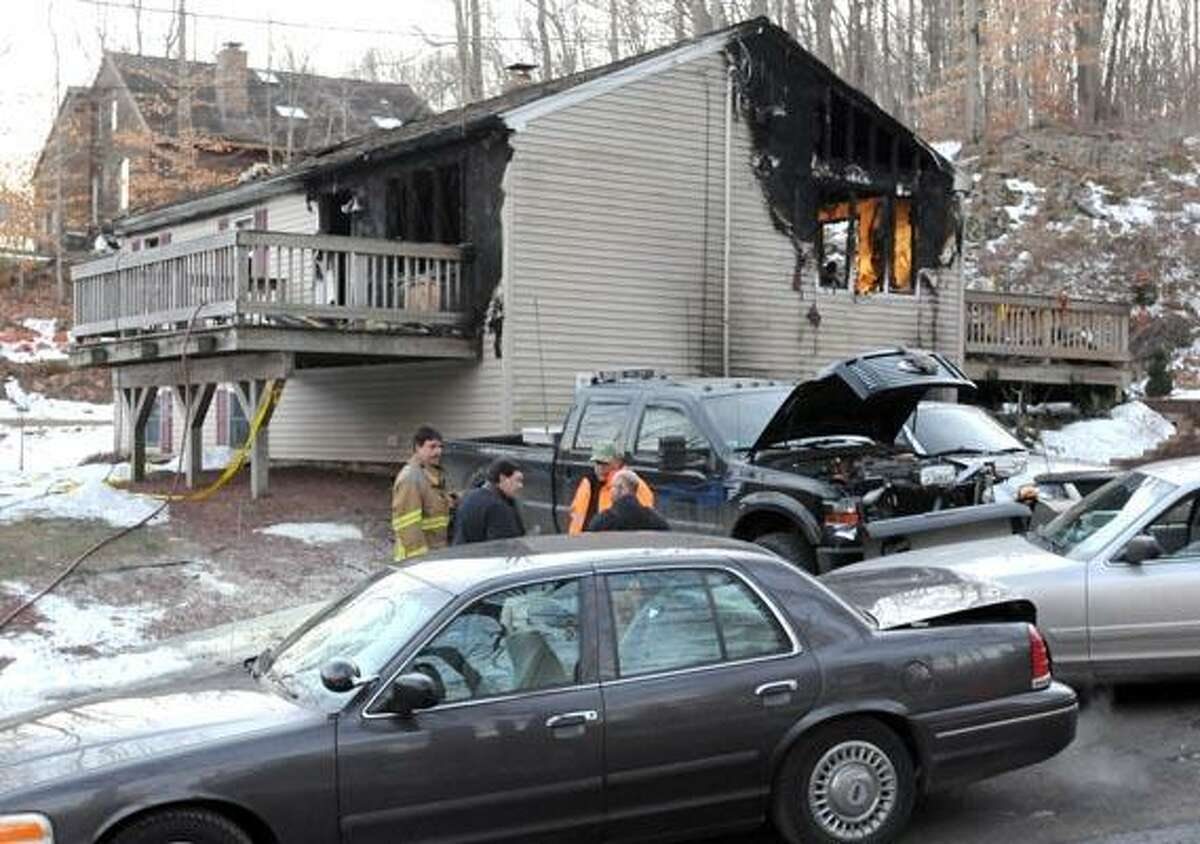 Fire investigators on the scene on Warner Rd. in East Haven. Photo by Mara Lavitt/New Haven Register1/3/11