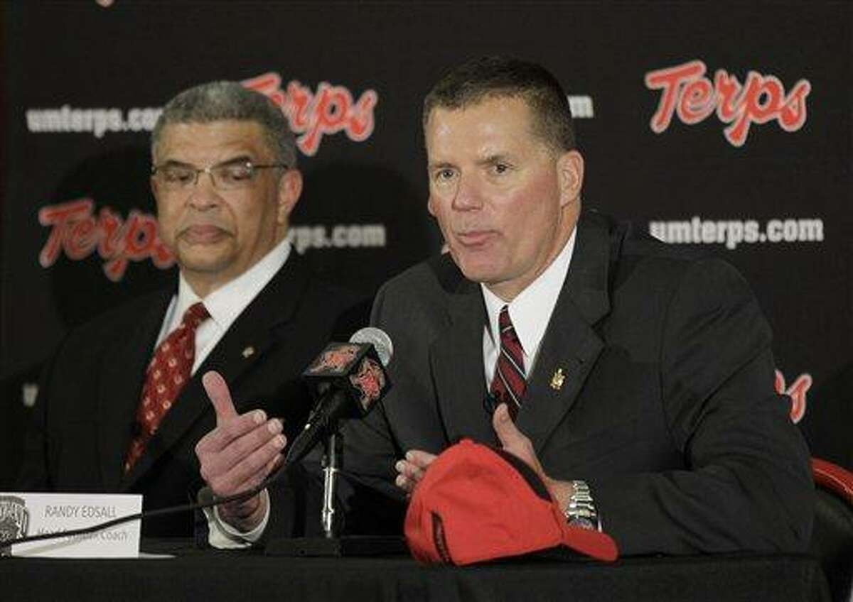 University of Maryland director of athletics Kevin Anderson, left, looks on as Randy Edsall speaks at a news conference after being introduced as the new head football coach at the school, Monday, Jan. 3, 2011, in College Park, Md. (AP Photo/Rob Carr)