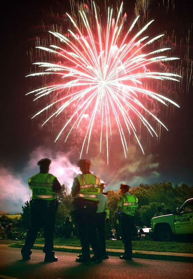 7/03/09 Cas090703 Peter CasolinoWallingford-- Wallinford police get a view of the Annual Wallingford town fireworks display as it lights up the sky over Hope Hill Road. Photo/Peter Casolino