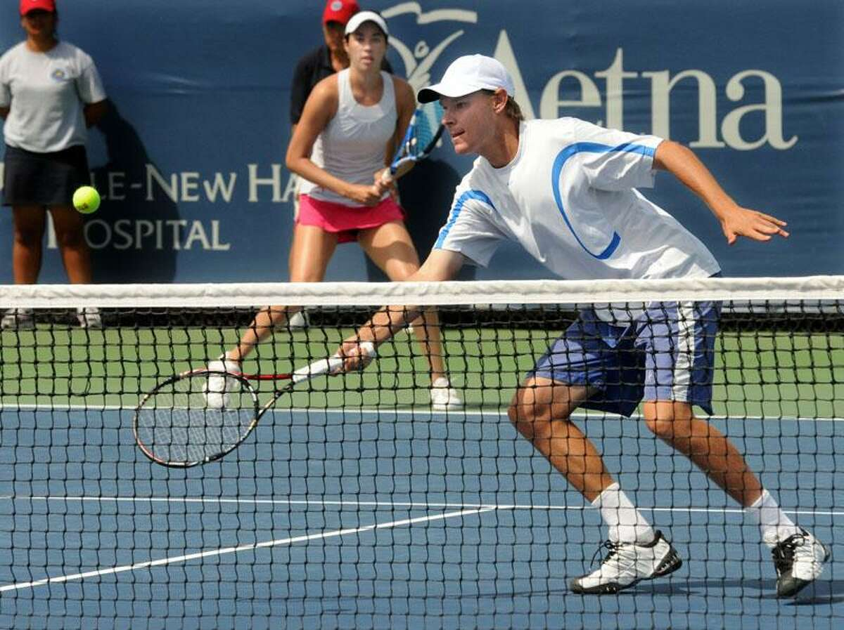 The New Haven Open at Yale at the CT Tennis Center: Mixed doubles partners Yasmin Schnack and Eric Roberson during the first set. They won over Whitney Jones and Blake Strode 6-3, 7-6. Photo by Mara Lavitt/New Haven Register8/24/11