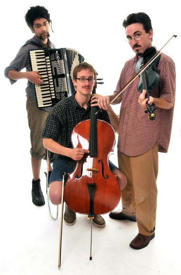 New Haven--Dr. Caterwaul's Cadre of Clairvoyant Claptraps:  Adam Matlock on accordian, Nathan Bontrager on cello, and Brian Slattery on violin.  Photo by Brad Horrigan/New Haven Register-06.29.11.