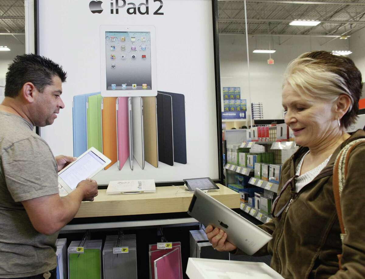Leticia Lozano, right, shops for a case for her new Apple iPad 2 tablet at Best Buy in Glendale, Calif. on April 6. Americans' concerns about jobs and inflation eased somewhat in April, pushing the Consumer Confidence Index higher. (AP Photo/Damian Dovarganes)