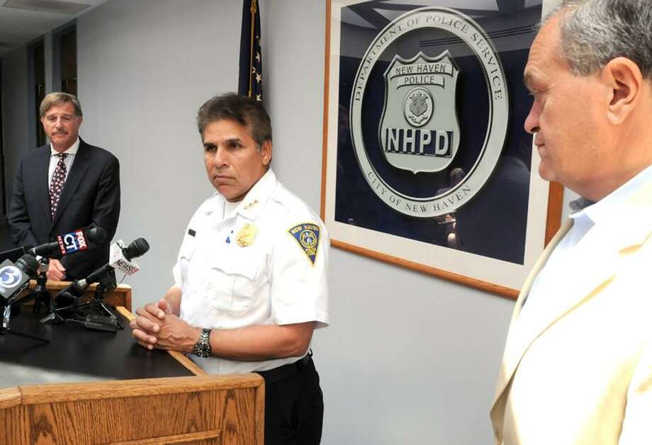 From left, New Haven Board of Police Commissioners Chairman Richard Epstein, police Chief Frank Limon and Mayor John DeStefano Jr. talk to the media Thursday about the city's new public safety surveillance cameras. Mara Lavitt/Register