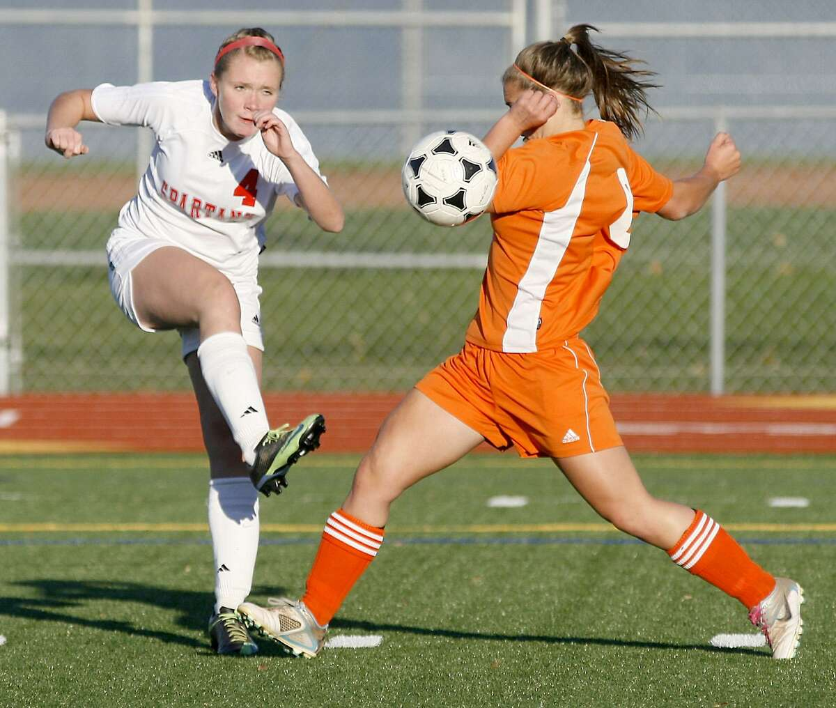 Dispatch Staff Photo by JOHN HAEGER twitter.com/oneidaphoto New Hartford's Lexie Raynard (4) crosses the ball into the center of the field as Oneida's Emily LaSalle (6) defends in the first half of the Sec III prelim in New Hartford on Tuesday, Oct. 25, 2011.